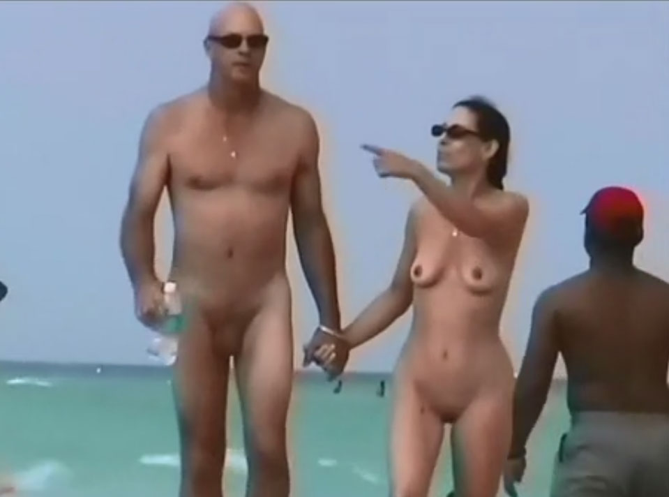 Couples naked on the beach