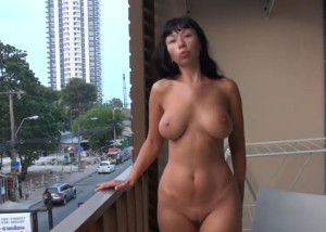 Naked on the balcony of the hotel