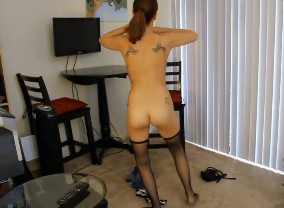 Cute brunette stripping naked at home