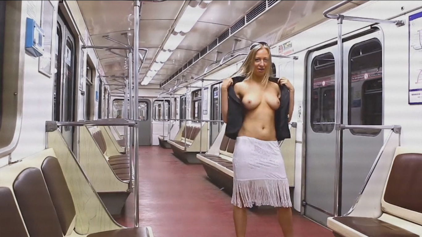 Topless blonde on the train