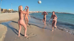 4 girls playing naked on the beach