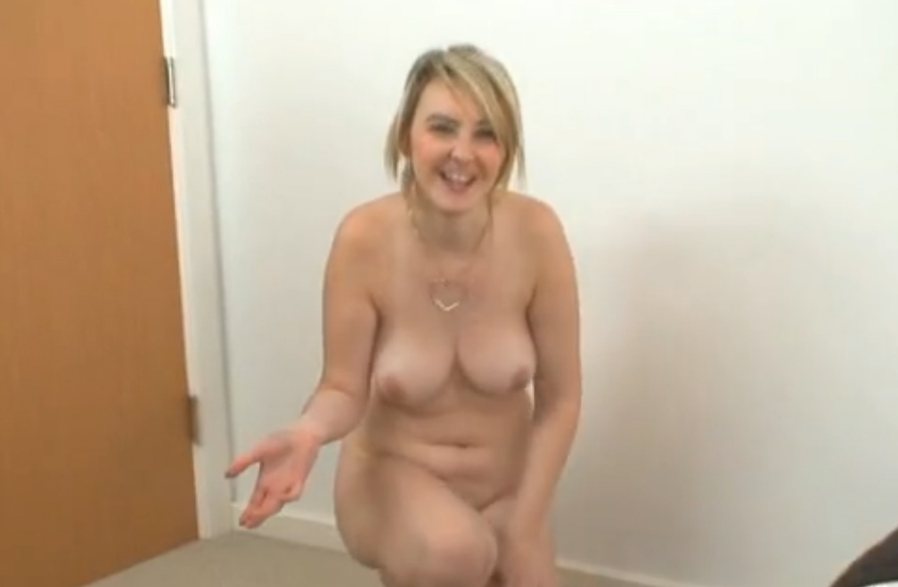 Cute blonde doing private striptease for her boyfriend