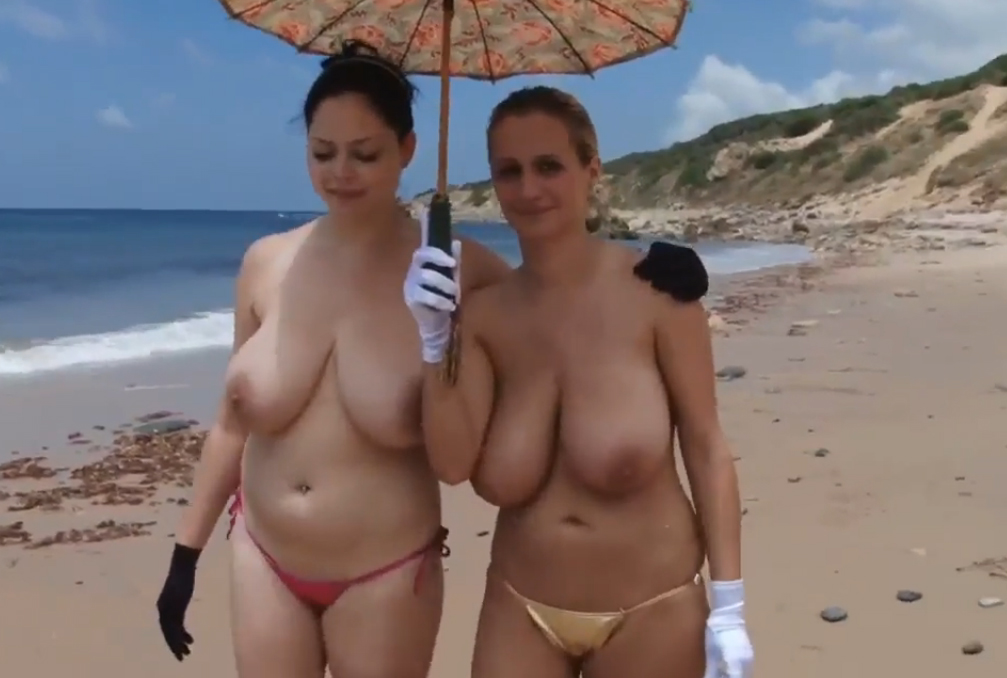 2 womens with huge boobs topless in the beach