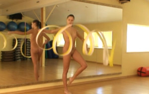 Naked gymnastic girl performs cool escercises
