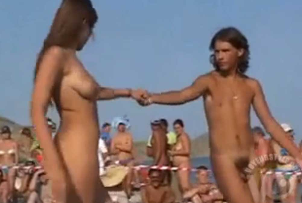 Naked couple dance at the beach