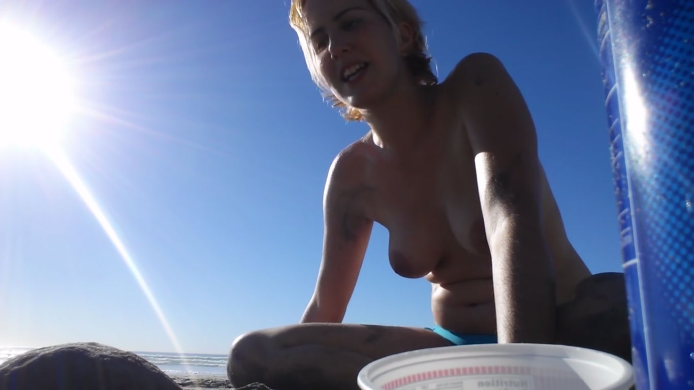 Topless beach girl talking about nudity