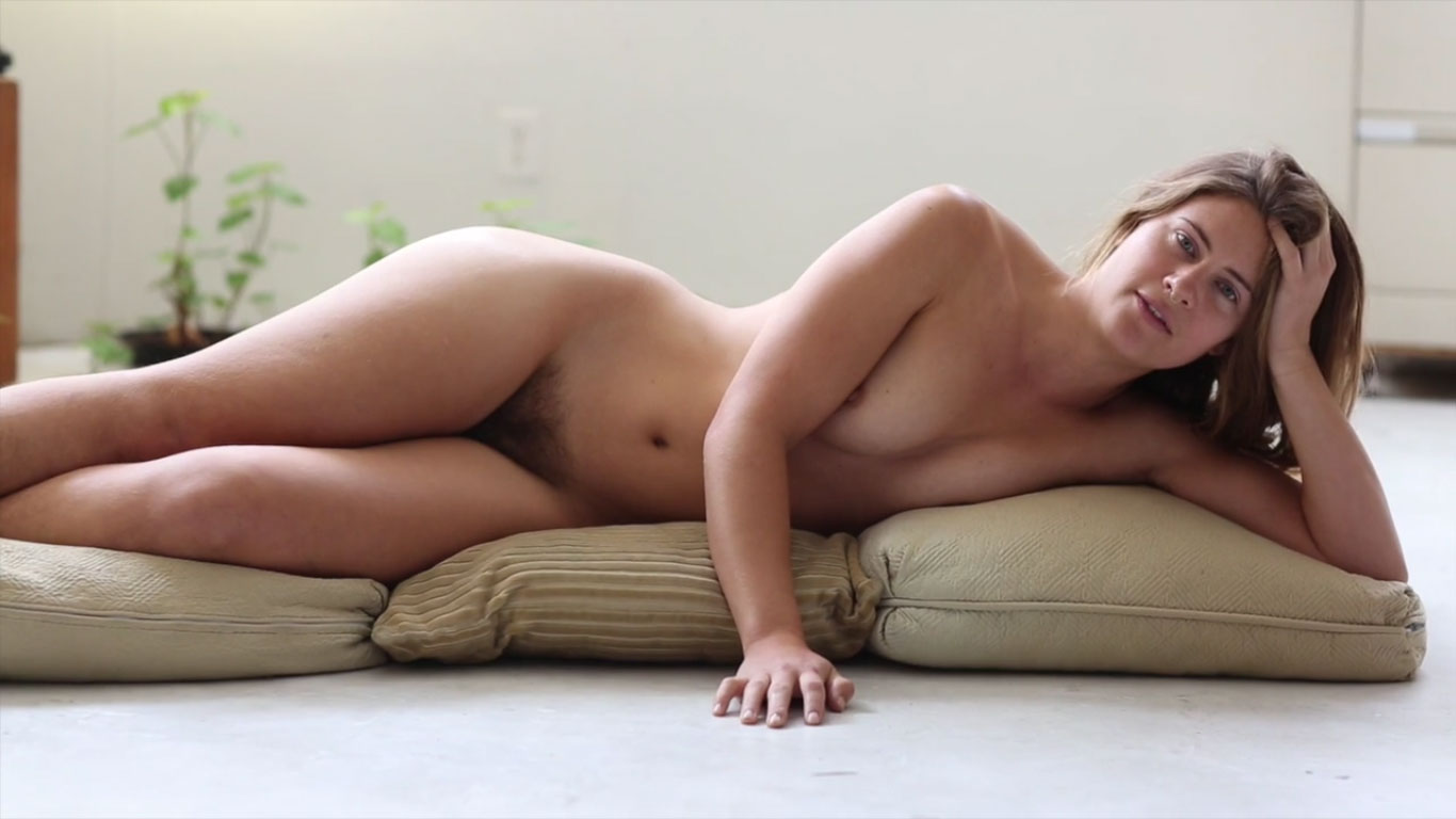 Naked model reading her poem