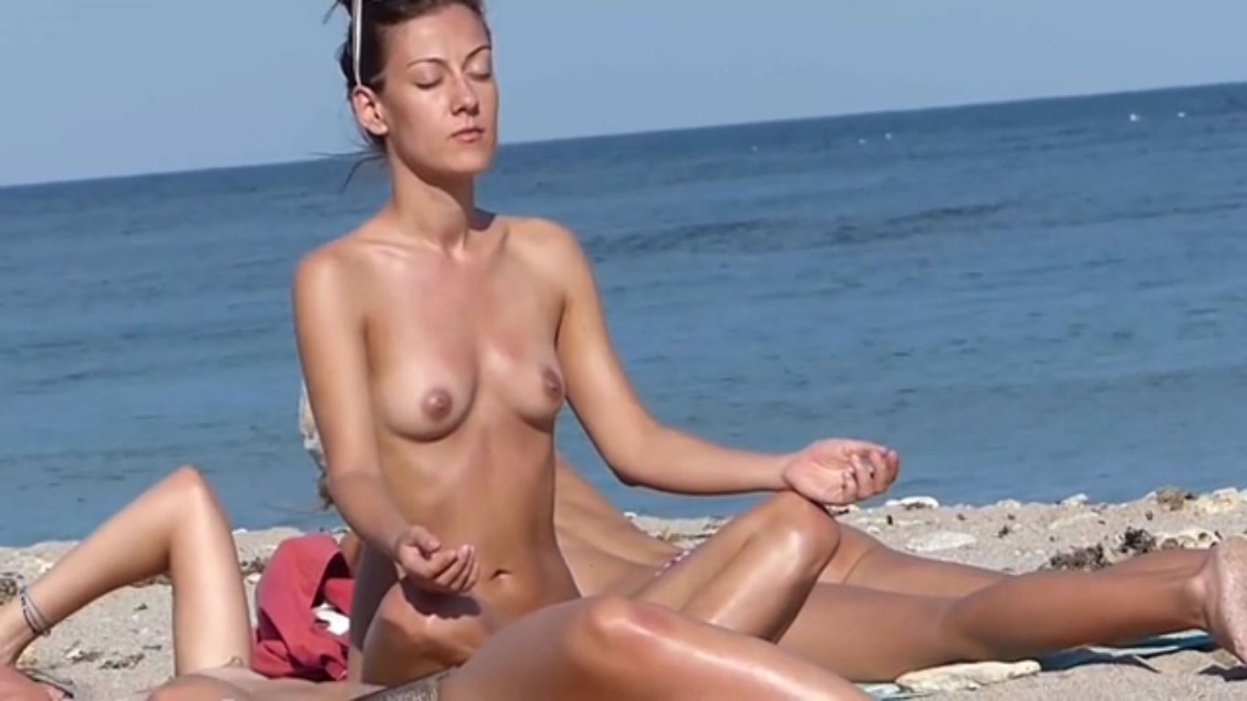 Naked meditation on the beach