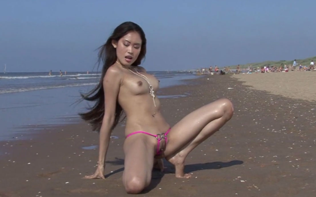 Asian girl naked in a public beach