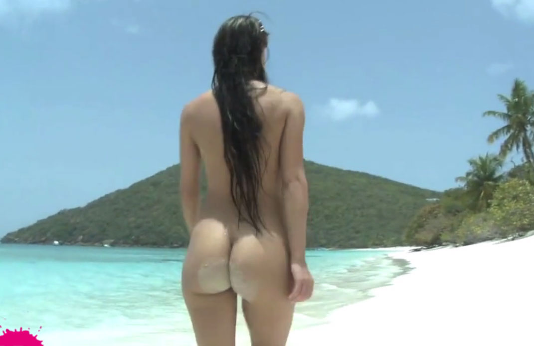 Naked model walking on a tropical beach