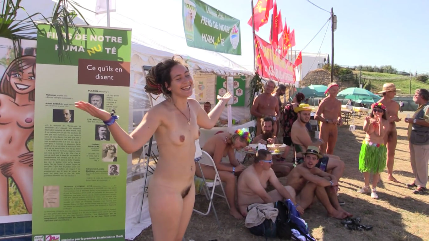 Young French girl takes off her clothes during a festival