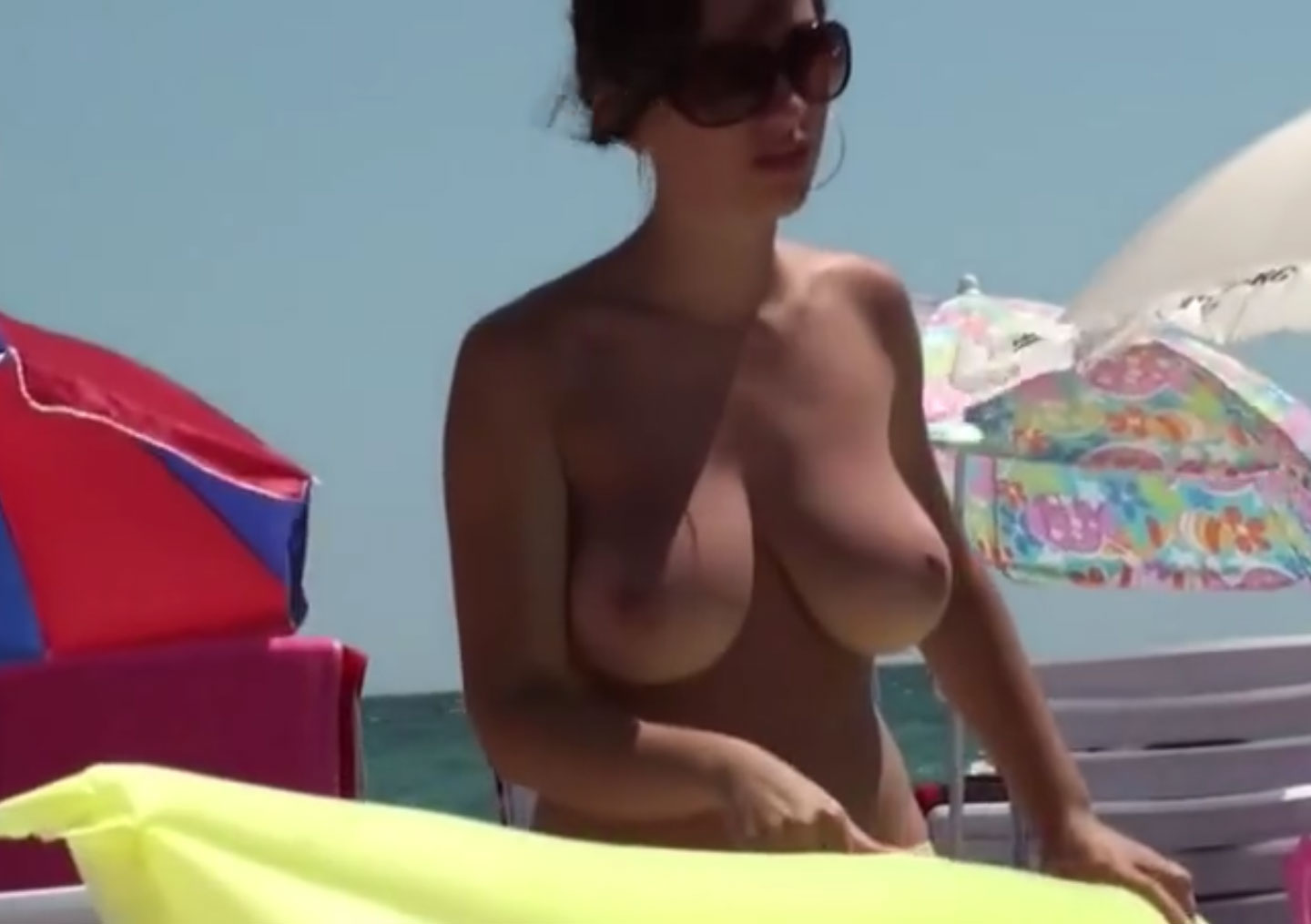 Sweet Brunette naked on th beach